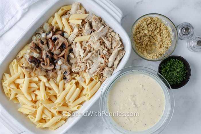 ingredients to make Turkey Casserole in bowls and a casserole dish