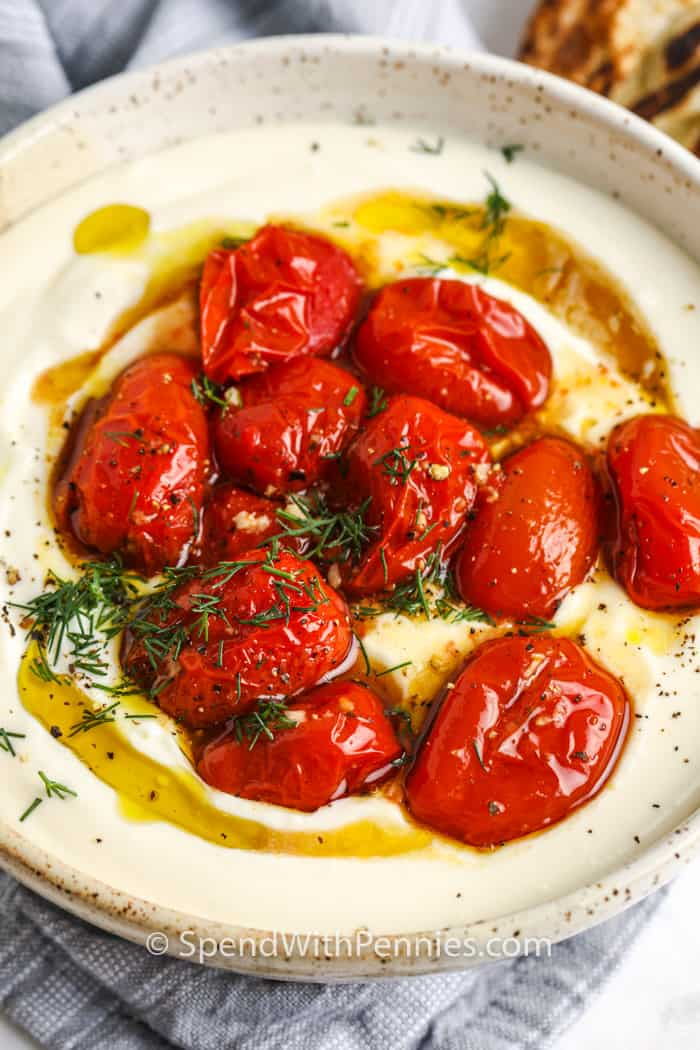 finished Whipped Feta in a bowl with tomatoes