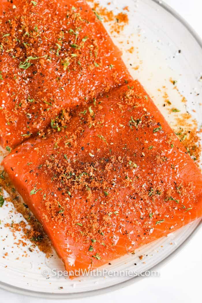 Air Fryer Salmon seasoned on a plate before frying