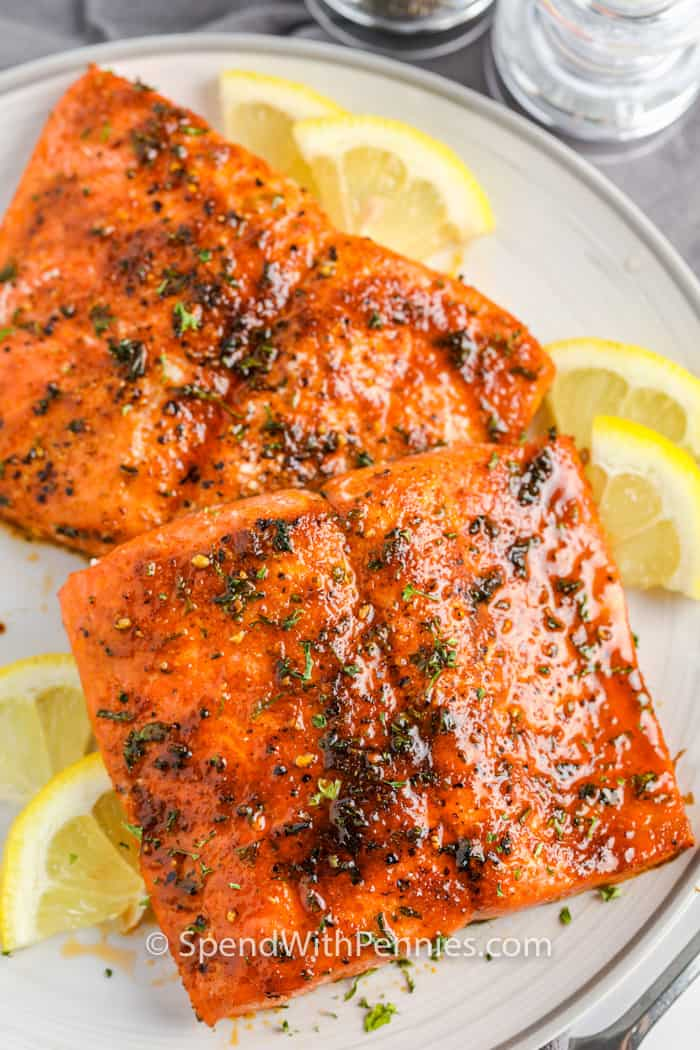Air Fryer Salmon on a plate with lemon slices