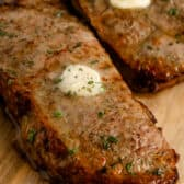 two Air Fryer Steaks with melted butter on top
