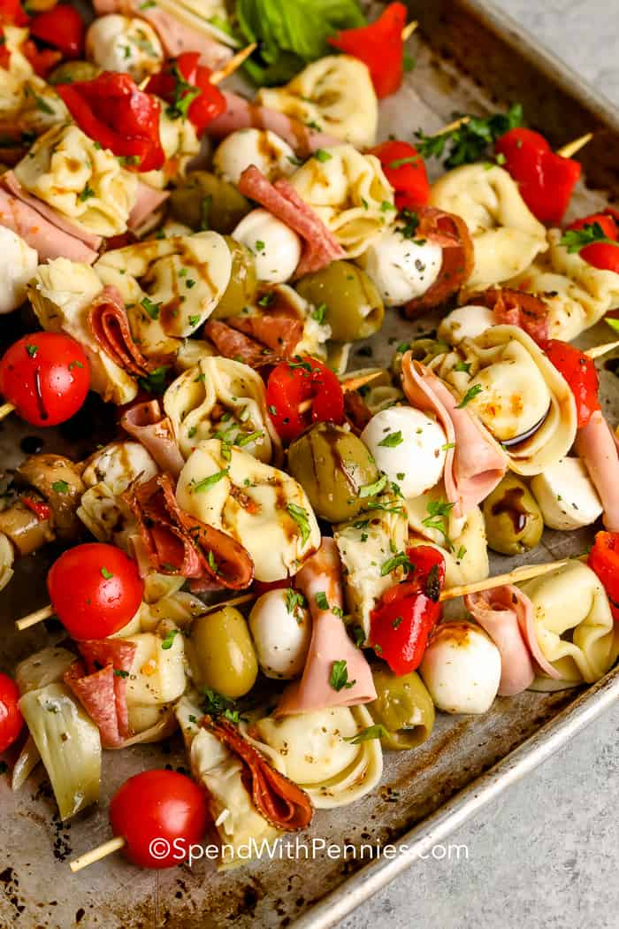 antipasto skewers on a baking sheet