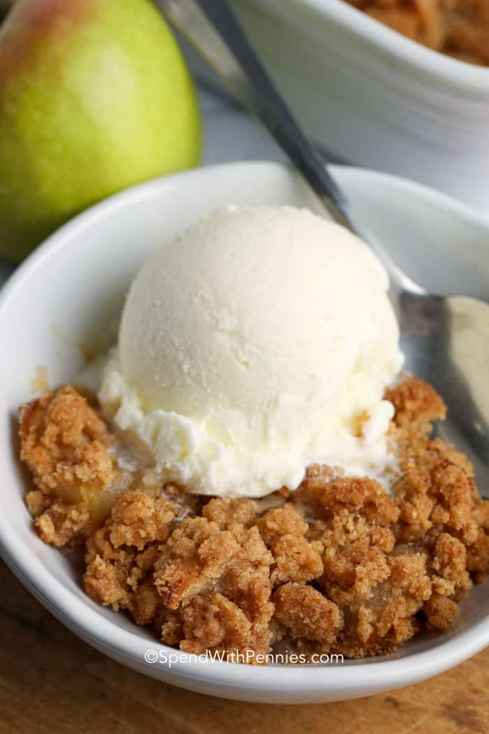 Baked Apple in a white bowl topped with ice cream