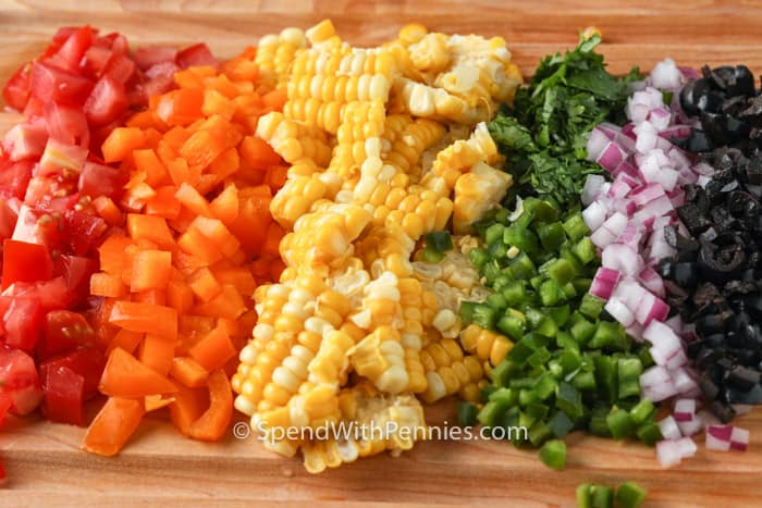 close up of vegetables on a cutting board to make Confetti Corn Dip