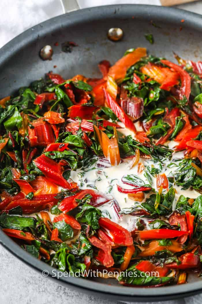 cream and swiss chard in a pan to make Creamed Swiss Chard