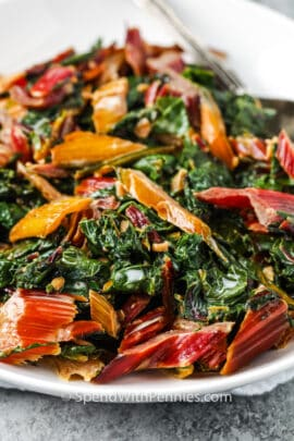 close up of Creamed Swiss Chard on a white plate