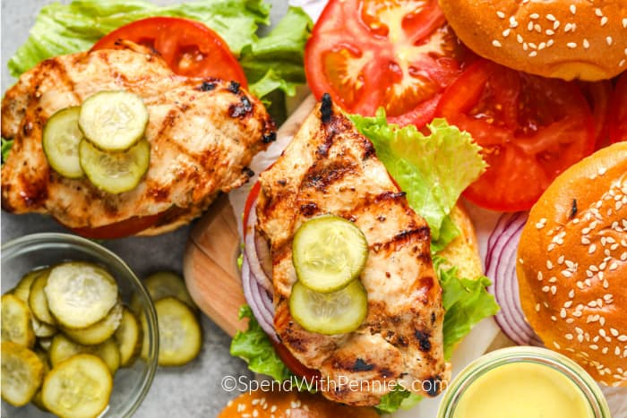Grilled Chicken sandwiches with pickles, lettuce and tomatoes