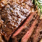 slices of juicy steak to show you How to Cook a Perfect Ribeye Steak