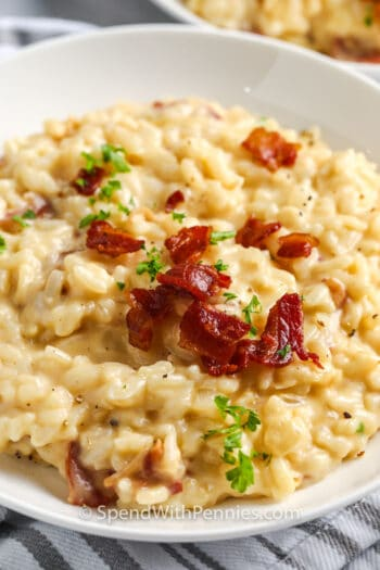 close up of Instant Pot Risotto on a white plate with bacon