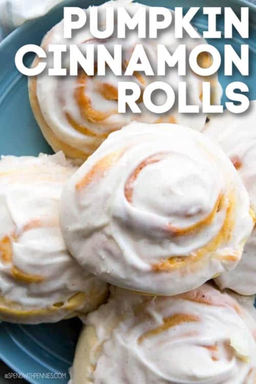Pumpkin Cinnamon Rolls on a plate with writing