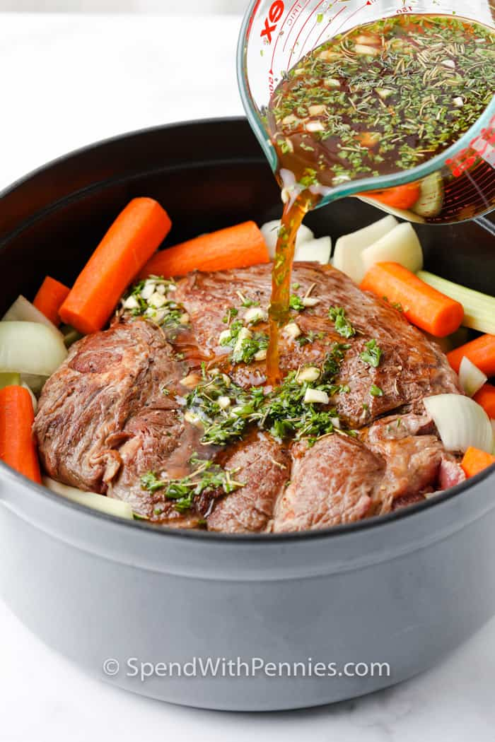 pouring sauce on Pot Roast (Chuck Roast) in a pot