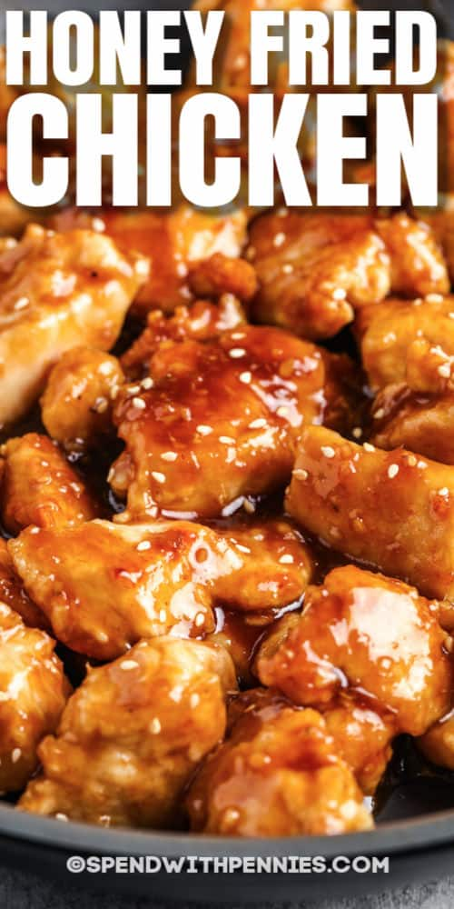 close up of Honey Chicken in a pan with a title