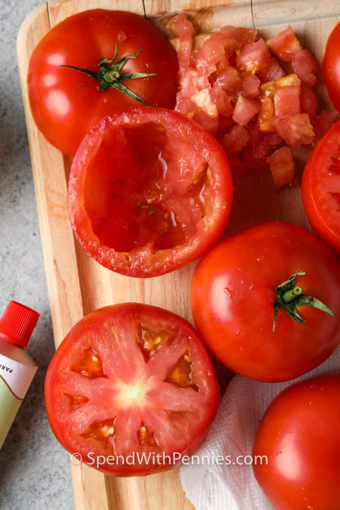 scooping out tomatoes to make Stuffed Tomatoes