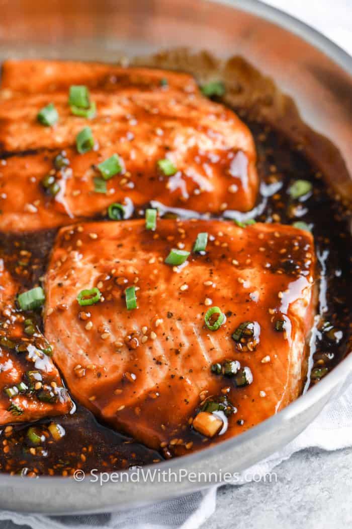 Teriyaki Salmon being glazed in a bowl