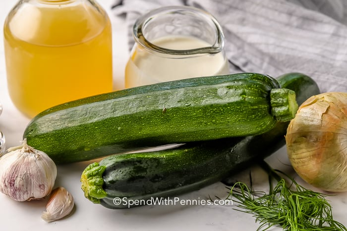 ingredients to make Zucchini Soup on a marble board