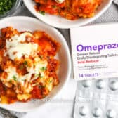 top view of 4 Ingredient Ravioli Casserole with a box of Omeprazole beside it