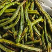 Air Fryer Green Beans on a plate with a fork
