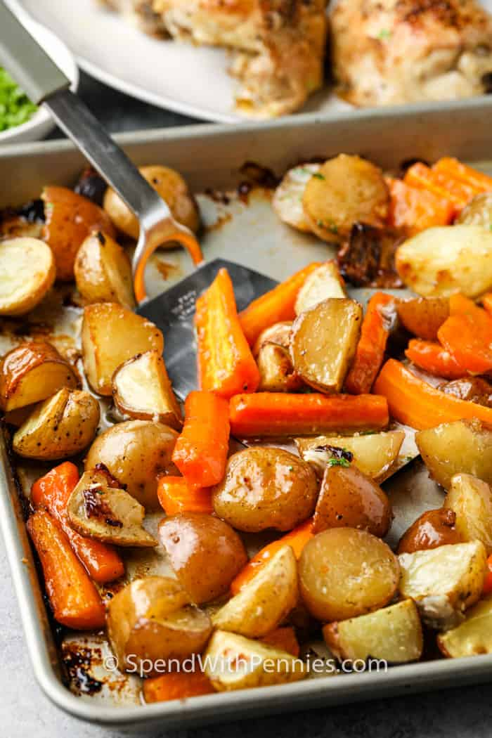 plating Chicken and Potatoes from a baking sheet