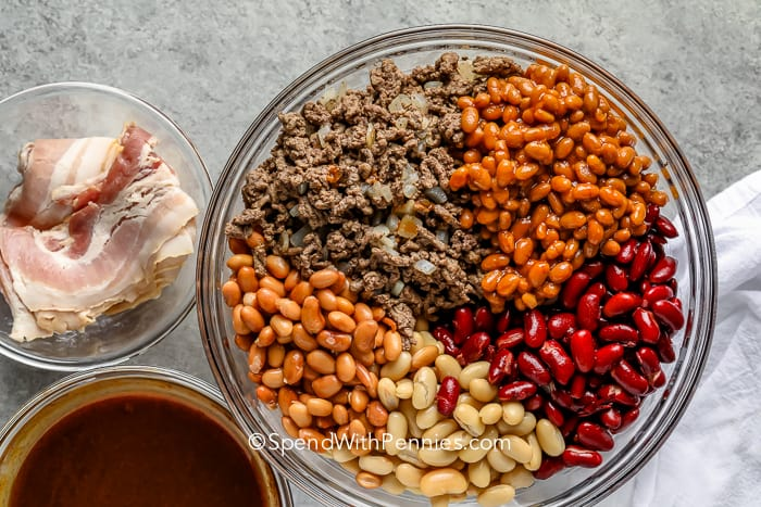 ingredients for Cowboy Baked Beans in a glass bowl