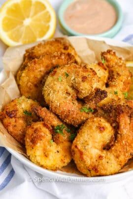 Crispy Air Fryer Shrimp in a bowl with dip