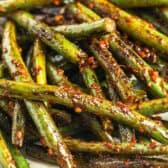 Szechuan Green Beans piled on a white plate