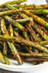 Szechuan Green Beans piled on a white plate