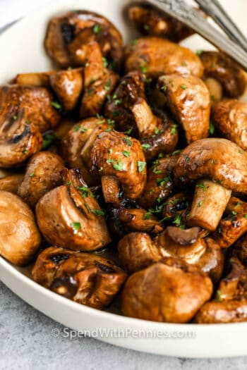 close up of Garlic Butter Air Fryer Mushrooms in a bowl