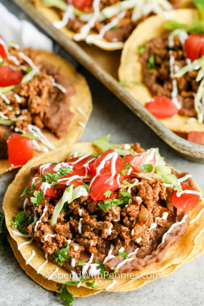 Ground Beef Tostadas on a baking sheet and table