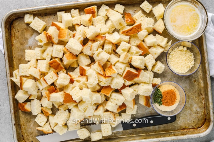 ingredients to make Homemade Croutons on a baking sheet