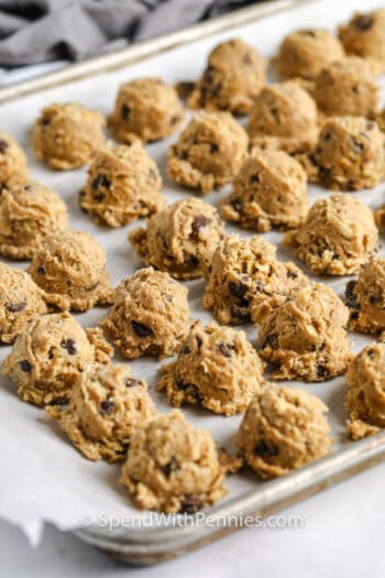pieces of cookie dough on a baking sheet to show How to Freeze Cookie Dough