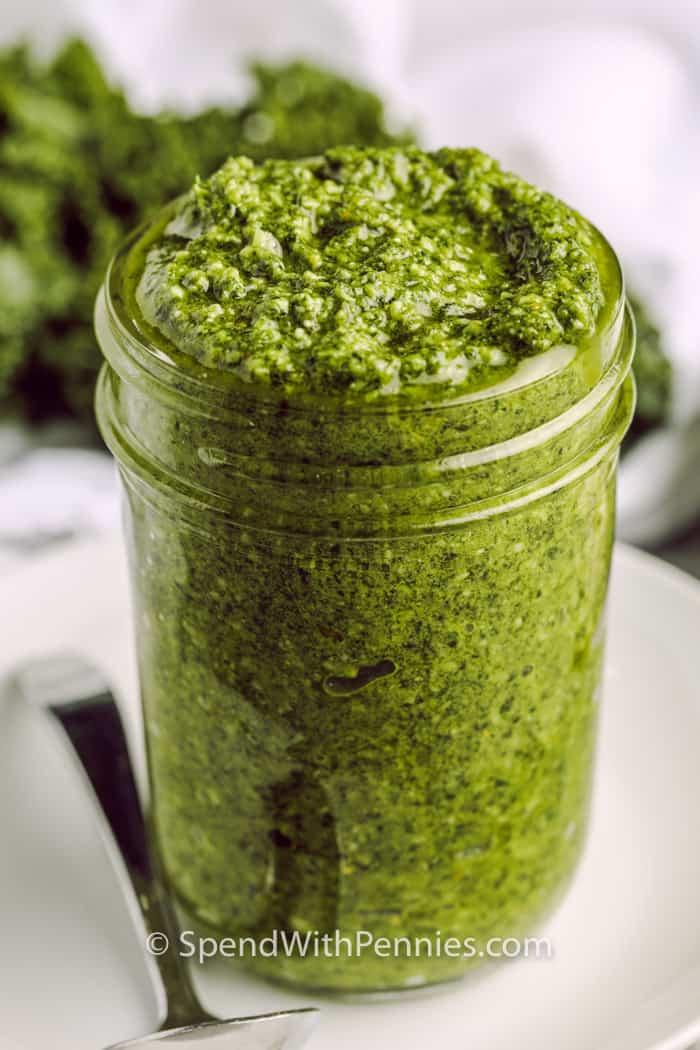 Kale Pesto in a jar with a spoon beside it