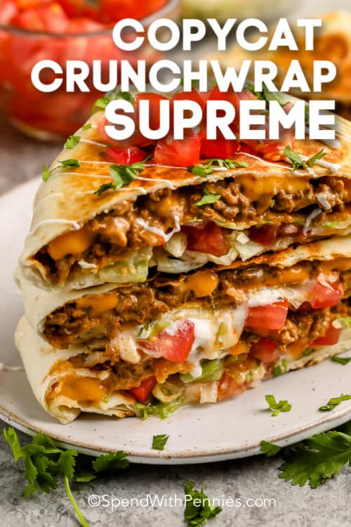 copycat Crunchwrap Supreme with tomatoes and cilantro on a plate with text