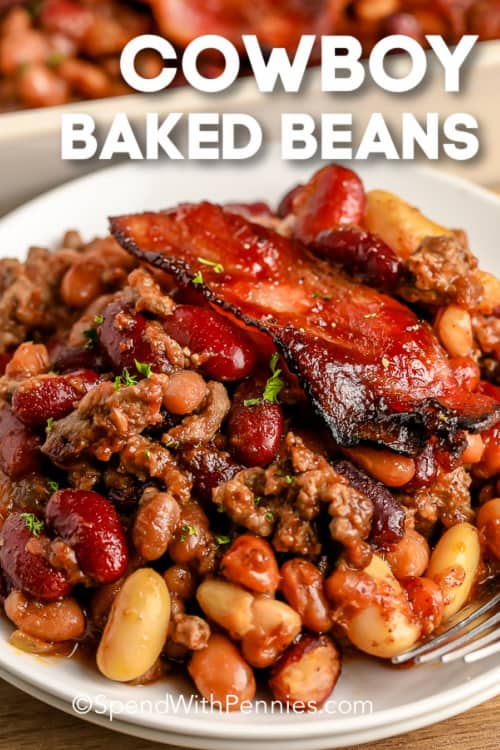 Cowboy Baked Beans on a plate with a fork and a title