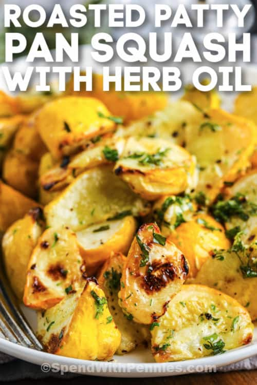 Roasted Patty Pan Squash with Herb Oil on a white plate with a fork and writing