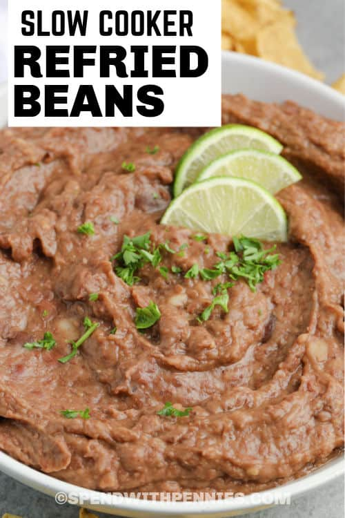 Slow Cooker Refried Beans in a bowl with writing