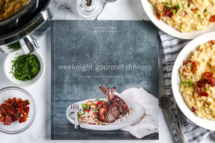 a cookbook with ingredients around it
