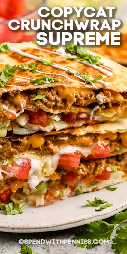 copycat Crunchwrap Supreme on a plate with cilantro and a title