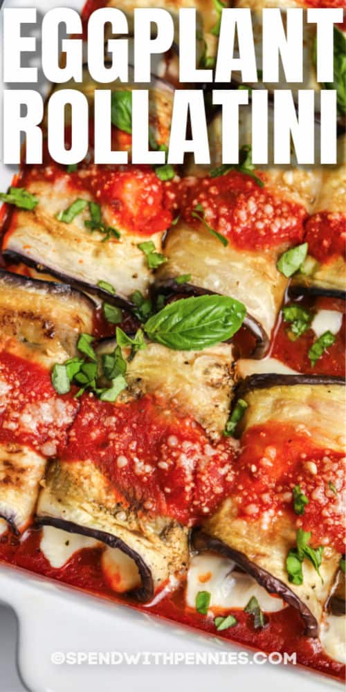 Eggplant Rollatini in a white casserole dish with writing