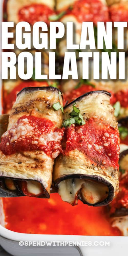 taking Eggplant Rollatini out of a casserole dish with a title