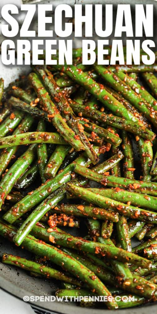 Szechuan Green Beans in the pan with a title