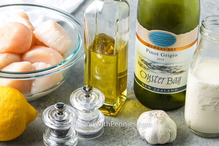 ingredients on a table to make Scallops in White Wine Sauce