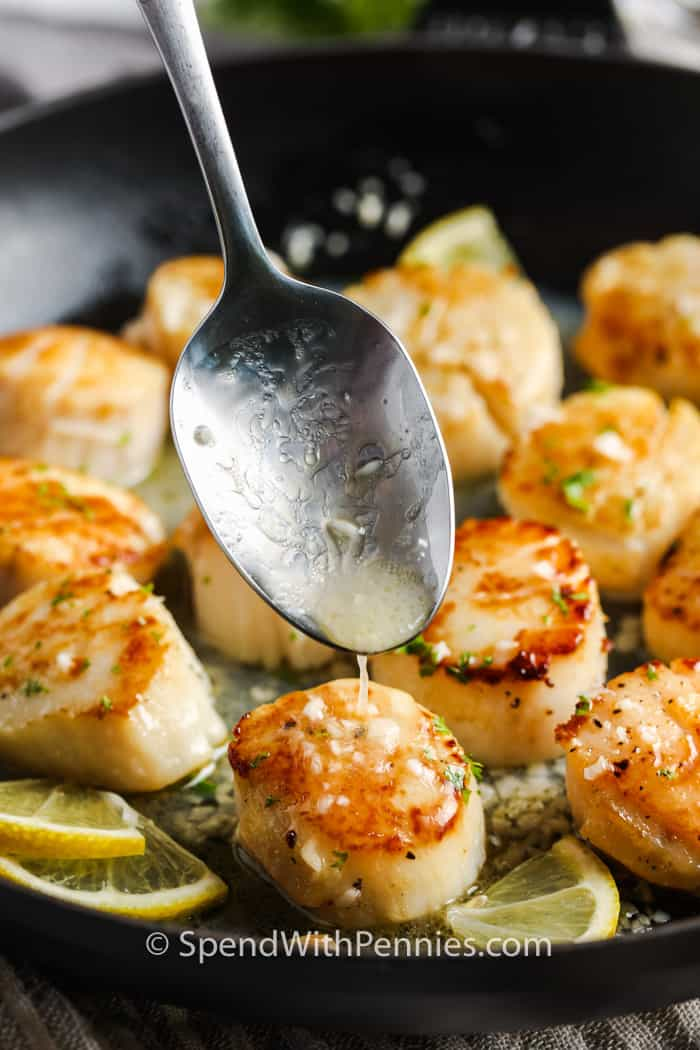 adding butter mixture to make (Simple) Seared Scallops