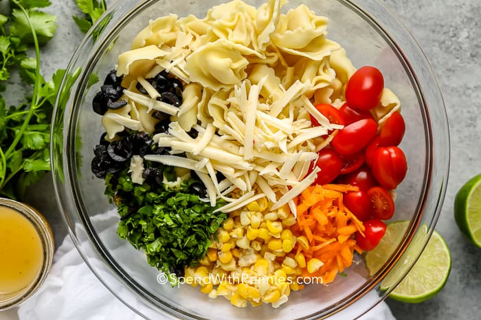 Tortellini Salad ingredients in a glass bowl