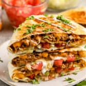 copycat Crunchwrap Supreme on a plate with cilantro