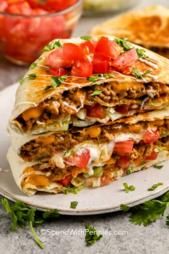 copycat Crunchwrap Supreme on a plate with tomatoes as garnish