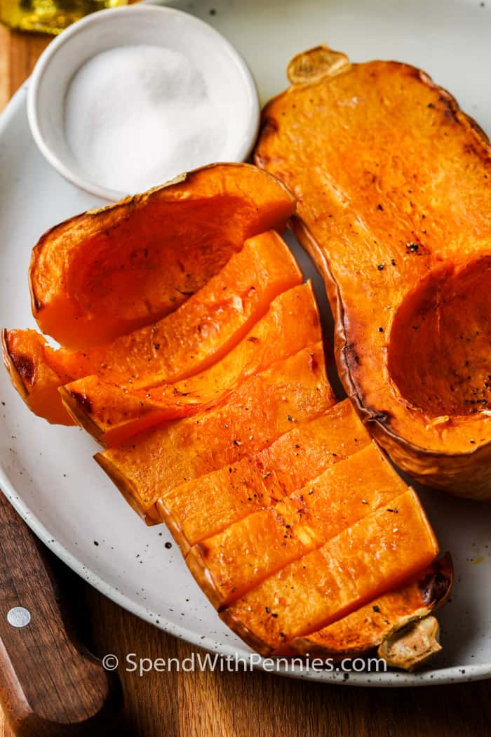 cooked Air Fryer Butternut Squash on a white plate with seasoning