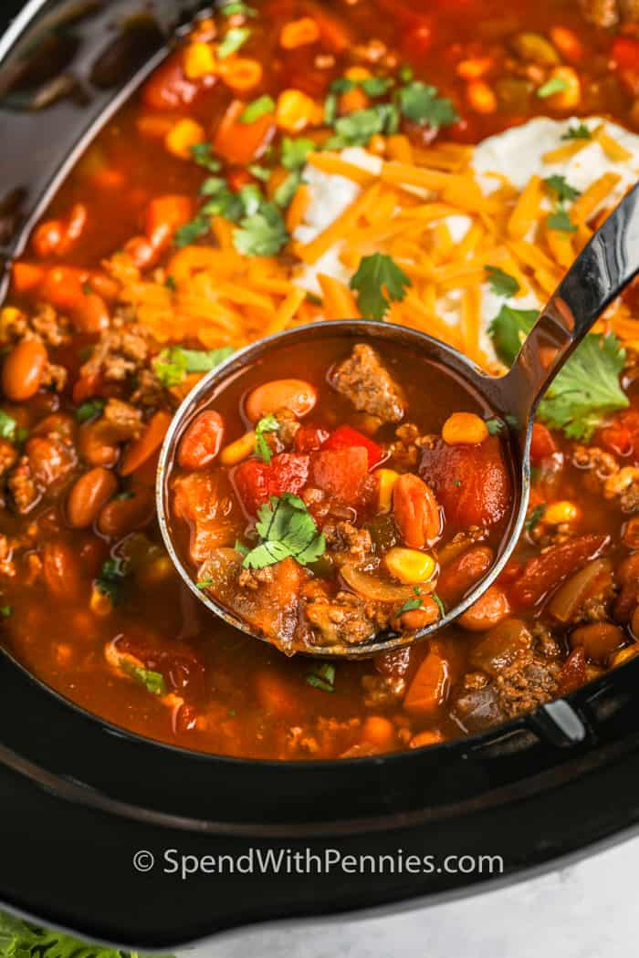 Crock Pot Taco Soup with a laddle taking a scoop