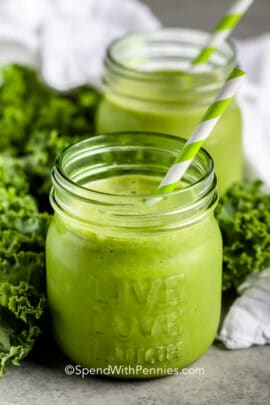 Kale Smoothie in two mason jars with straws