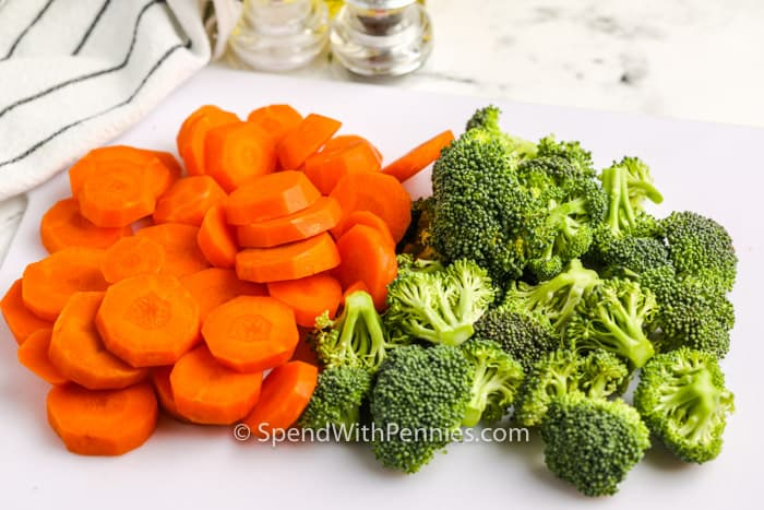 carrots and broccoli cut up to make Roasted Broccoli and Carrots