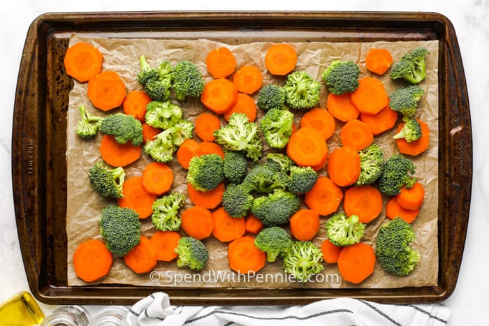 top view of Roasted Broccoli and Carrots on a baking sheet before cooking